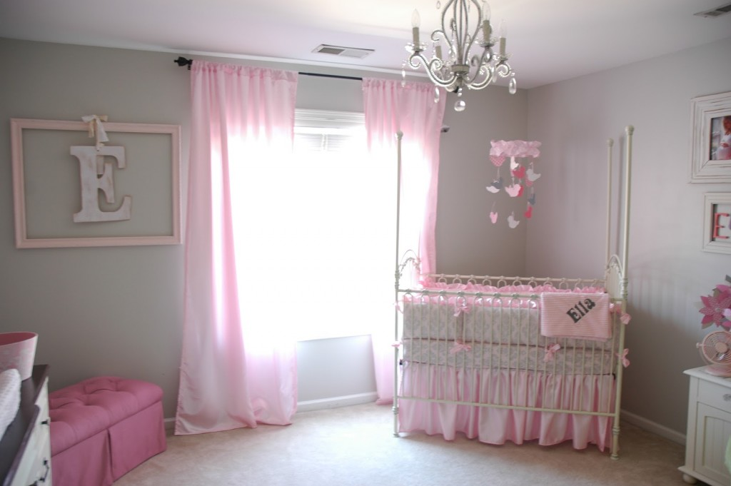 Endearing pink curtains for white wooden baby crib also pink